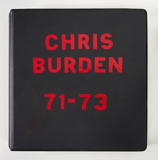 Chris Burden, Deluxe Photo Book 1971–73, 1974 Gelatin silver prints, chromogenic prints, and typewritten note in loose-leaf binder with hand-painted cover, 12 x 12 x 3 inches (30.5 x 30.5 x 7.6 cm), edition of 50© Chris Burden/Licensed by The Chris Burden Estate and Artists Rights Society (ARS), New York