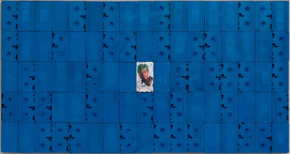 Harmony Korine, Blue Anamorphic Blockbuster, 2018 Oil stick, oil-based paint marker, spray paint, and house paint on VHS cassettes and covers mounted on board, 37 × 70 inches (94 × 177.8 cm)© Harmony Korine. Photo: Rob McKeever