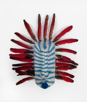 Romuald Hazoumè, Oiseau bleu, 2018 Plastic and rooster feathers, 15 × 15 × 6 ⅜ inches (38 × 38 × 16 cm)© 2018 Romuald Hazoumè and Artists Rights Society (ARS), New York/ADAGP, Paris. Photo: Zarko Vijatovic