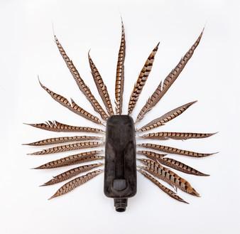 Romuald Hazoumè, Curazao, 2018 Plastic and pheasant feathers, 33 ⅛ × 30 ¾ × 8 ¾ inches (84 × 78 × 22 cm)© 2018 Romuald Hazoumè and Artists Rights Society (ARS), New York/ADAGP, Paris. Photo: Zarko Vijatovic