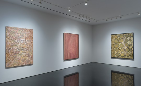 Installation view Artwork, left to right: © Emily Kame Kngwarreye/Copyright Agency. Licensed by Artists Rights Society (ARS), New York, 2019; © Willy Tjungurrayi; © Ronnie Tjampitjinpa. Photo: Rob McKeever