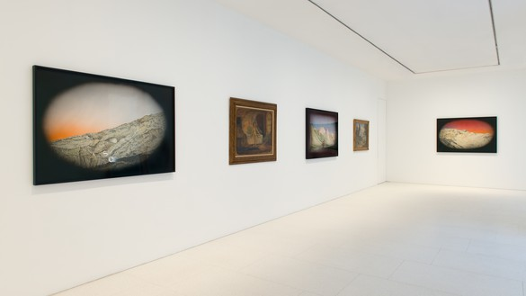Installation view with work by Ed Ruscha (left, center, right) and Louis Michel Eilshemius Artwork, left, center, and right: © Ed Ruscha. Photo: Joanna Fernandes
