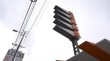 Still from Ed Ruscha's film L.A. Restaurants, 2019, showing the sign on Norms restaurant in Los Angeles