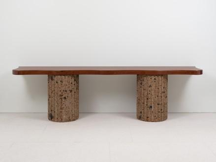 Curzio Malparte, Console, 1941/2020 Walnut and tuff, 28 ½ × 106 ½ × 19 ⅜ inches (72.4 × 270.5 × 49 cm), edition of 12 + 2 AP© Malaparte Design. Photo: Prudence Cuming Associates