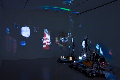 Sarah Sze, Plein Air (Times Zero), 2020 Mixed media, including wood, stainless steel, video projectors, archival paper, toothpicks, clamps, ruler, and tripods, installation dimensions variable© Sarah Sze. Photo: Thomas Lannes