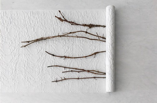 Giuseppe Penone, Impronte di corpi nell'aria (Bodies Imprinted in the Air), 2021 White Carrara marble and bronze, 39 ⅜ × 59 ⅛ × 5 ½ inches (100 × 150 × 14 cm)© 2021 Giuseppe Penone/Artists Rights Society (ARS), New York/ADAGP, Paris