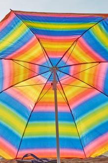 Roe Ethridge, Rainbow Beach Umbrella with Flip Flops, 2020 Dye sublimation print on aluminum, 60 × 40 inches (152.4 × 101.6 cm), edition 1/5 + 2 AP© Roe Ethridge