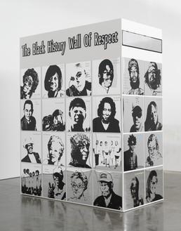 Lauren Halsey, black history wall of respect (II), 2021 Vinyl, acrylic, and mirror on wood, 19 ⅞ × 96 ⅛ × 48 inches (50.5 × 244.2 × 122.2 cm)© Lauren Halsey. Photo: Rob McKeever
