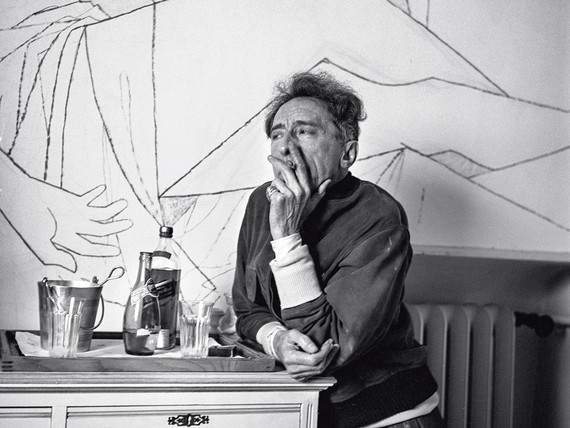 Jean Cocteau in front of one of the several murals he painted on the walls of Francine Weisweiller's Villa Santo Sospir, Saint-Jean-Cap-Ferrat, France, 1954. Photo: Edward Quinn