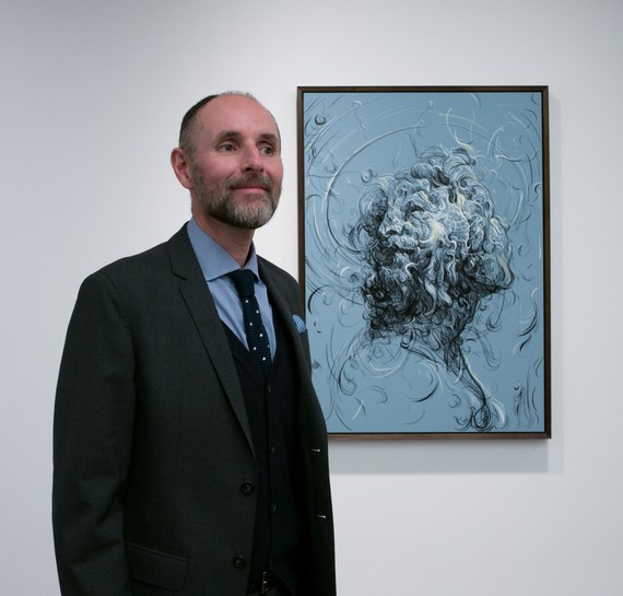 Glenn Brown with his painting In the end we all succumb to the pull of the molten core (2016). Photo: Edgar Laguinia