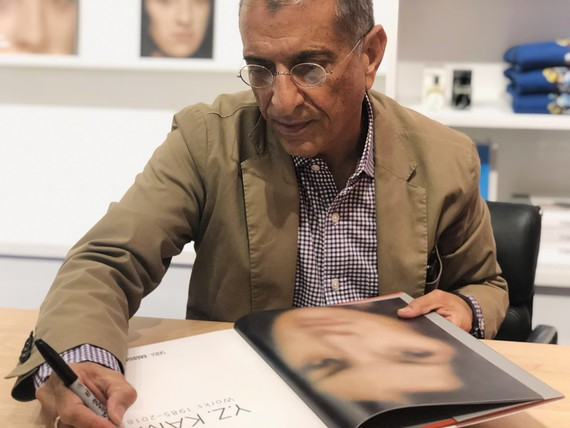 Y.Z. Kami signing a copy of his monograph at the Gagosian Shop, New York, 2019