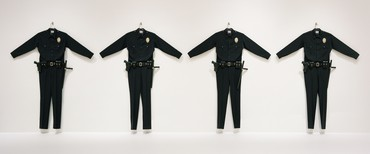 Chris Burden, L.A.P.D. Uniforms, 1993, installation view, Made in California: Art, Image and Identity, 1900–2000, Los Angeles County Museum of Art © Chris Burden/Licensed by the Chris Burden Estate and Artists Rights Society (ARS), New York. Photo: Museum Associates/LACMA