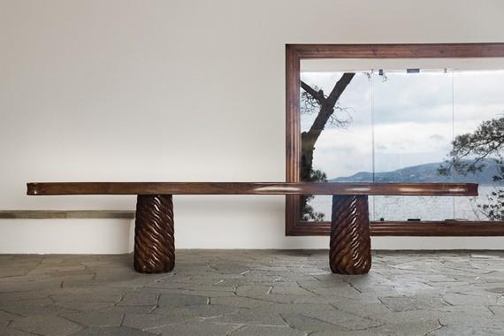 Original walnut and pine table conceived in 1941 by Curzio Malaparte in situ at Casa Malaparte, Capri © Malaparte. Photo: Dariusz Jasak
