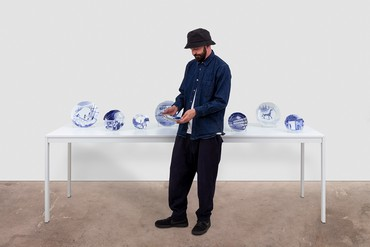 Piero Golia with his set of eight porcelain plates The Best Is Yet to Come (2020), Los Angeles, 2020. Artwork © Piero Golia. Photo: Joshua White/JWPictures.com
