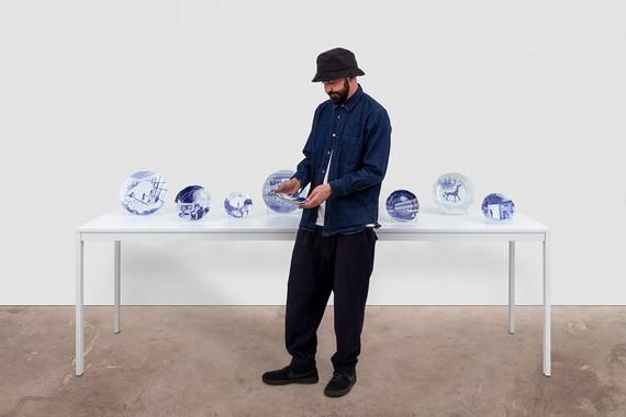 Piero Golia with his set of eight porcelain plates The Best Is Yet to Come (2020), Los Angeles, 2020. Artwork © Piero Golia. Photo: Joshua White/JWPictures.com