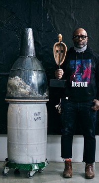 Theaster Gates standing next to his sculpture Vessel #20 (2020). Artwork © Theaster Gates. Photo: Chris Strong