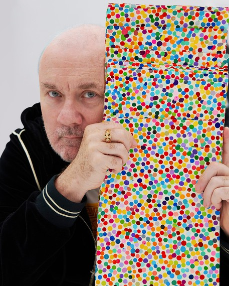 Damien Hirst with works from The Currency (2016). Artwork © Damien Hirst and Science Ltd, DACS 2021. Photo: Prudence Cuming Associates Ltd