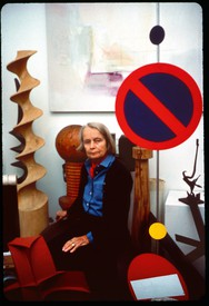 A portrait of Betty Parsons surrounded by art.