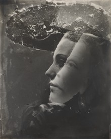 A black-and-white photograph of a woman's face by Dora Maar.