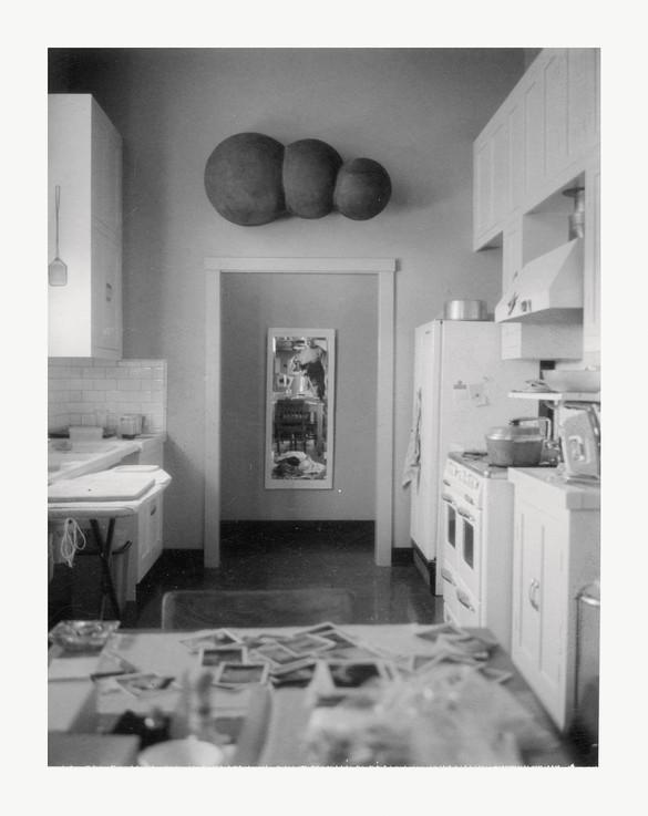 Robert Therrien, No title (self-portrait in kitchen), c. 1995, Polaroid, 4 ¼ × 3 ⅜ inches (10.8 × 8.6 cm)
