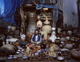 Takashi Murakami with works from his ceramics collection.