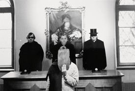 Thomas McEvilley, Ulay (hiding behind a slab of wood), Eric Orr, and James Lee Byars, c. 1995 © Ulay, courtesy ULAY Foundation/Artists Rights Society (ARS), New York
