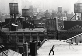 "Dancer on Soho roof in performance ""Roof Piece,"" New York, 1973"