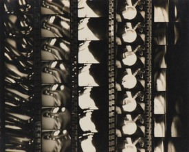 Vertical film strips from Man Ray's films.