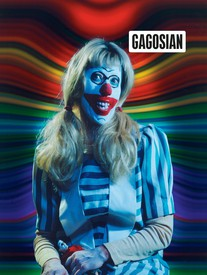 The cover of the Spring 2020 edition of the Gagosian Quarterly magazine. A Cindy Sherman photograph of herself dressed as a clown against a rainbow background.