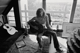 Graham Nash at home, San Francisco, 1972. An M. C. Escher print from his collection can be seen on the floor to the right. Photo: Joel Bernstein