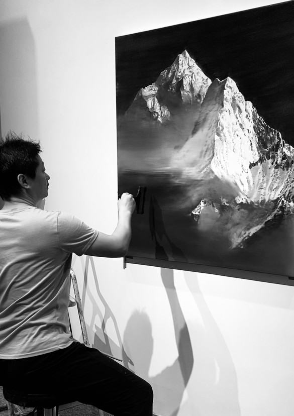 Jia Aili working on the painting Everest (2020) in his studio in Beijing