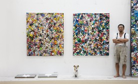 Takashi Murakami with his dog, Pom, Full Steam Ahead, Dark Matter in the Farthest Black Reaches of Visible Space, and Blue Flowers & Skulls (all 2012), Kaikai Kiki Co., Ltd., studio, Saitama, Japan, 2012