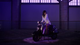 "Charlotte Gainsbourg on a motorscooter in a film still from Jim Jarmusch and Anthony Vaccarello's ""French Water"""