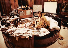 Hugh Hefner working from his bed at the Playboy Mansion