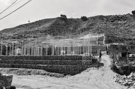 Rendering of framework for the new UCSD-Alacrán Community Station housing project on the remediated site, Alacrán Canyon, Tijuana, Mexico. Rendering: Estudio Teddy Cruz + Fonna Forman (Marcello Maltagliati)