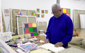 Stanley Whitney in his New York studio, surrounded by paintings and drawings