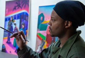 Titus Kaphar in his studio, painting