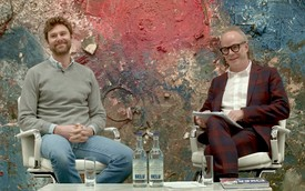 Video still of Dan Colen seated onstage with Hans Ulrich Obrist.