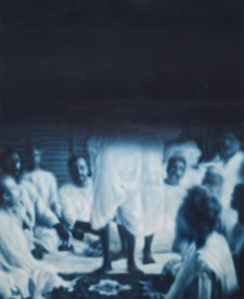 A painting in dark blue and white. The image depicts a group of men in white linen encircling a platform on which a couple of them are standing. The standing figures are cut off from the waist up as the top half of the painting dissolves into solid midnight blue.